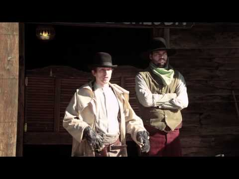 Two cowboys standing at gallows